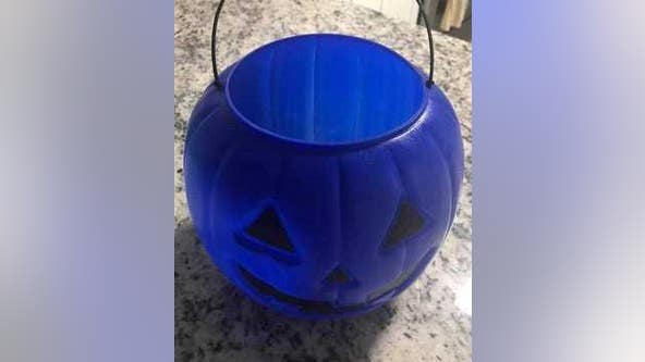 Raising autism awareness with blue Halloween buckets
