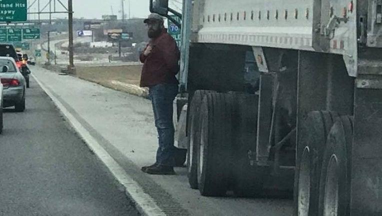 75d06224-Vet_Trucker Stops For Vets Funeral Procession Courtesy Kristen Collins-401096