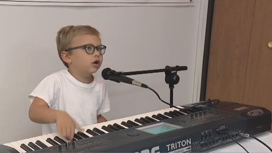 7-year-old blind piano prodigy lights up Livonia visiting Seedlings braile books