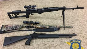 Drunk man passed out in car arrested in Macomb Co., 3 long guns seized