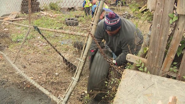 Volunteers clean up discarded tires in Detroit while homeless and disabled turn them into mats