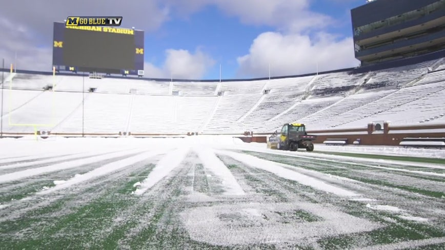 Removing the snow at U-M's Big House in time for the MSU game