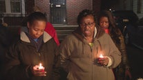 Family members gather at home where 2 were killed by relative during argument
