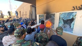 Iraqi supporters of Iran-backed militia attack US Embassy compound in Baghdad