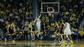 No. 4 Michigan tops Iowa 103-91