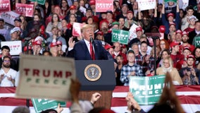 Trump blasts impeachment effort at Michigan rally as Congress votes to impeach