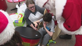 Santa dropped by a nonprofit that assists blind and handicapped kids Friday. And he brought presents