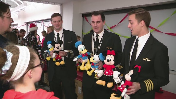 Kids get break from therapy at Beaumont holiday party with airline pilots