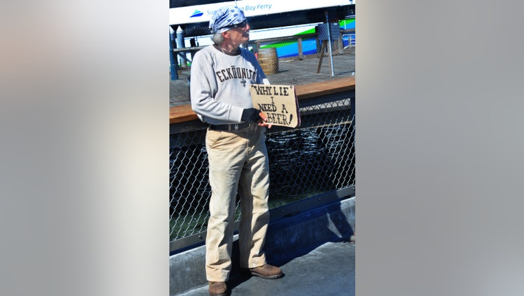 SAN FRANCISCO, CA - MAY 16, 2013: A 'panhandler' with a sense of humor solicits handouts at San Francisco's Fisherman's Wharf district, a popular shopping, entertainment and restaurant complex. (Photo by Robert Alexander/Archive Photos/Getty Images)