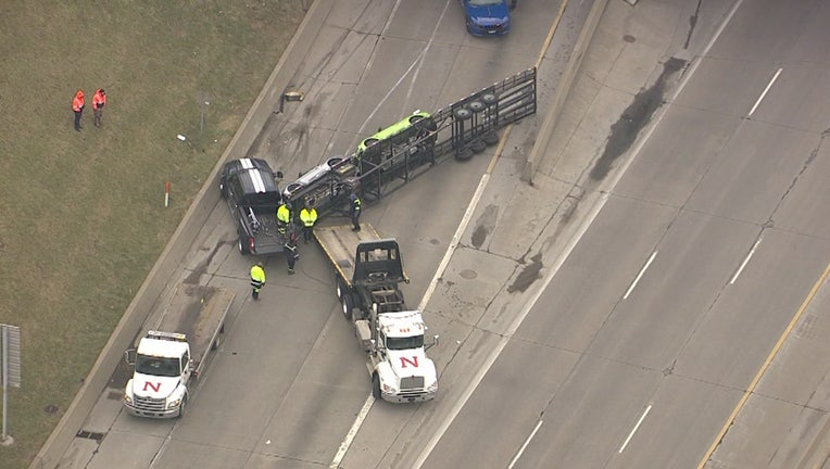 The Michigan Department of Transportation said a car transporter flipped on I-75 in Detroit.