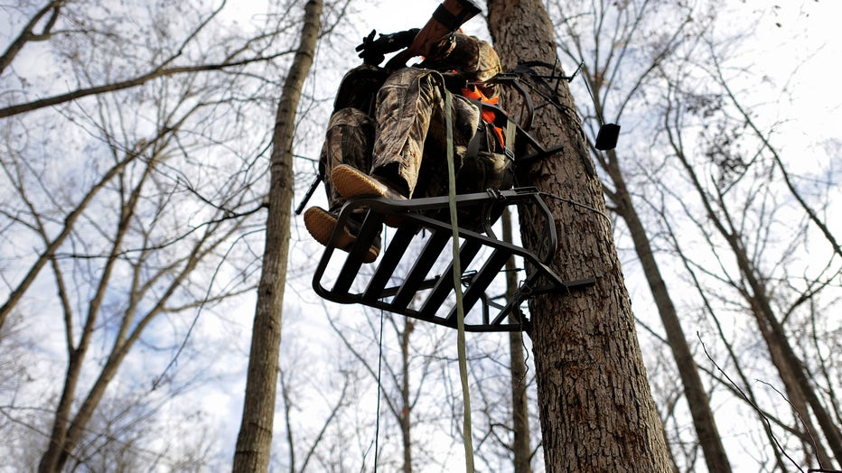 Michigan deer hunter sprays deer repellent on brother's deer stand