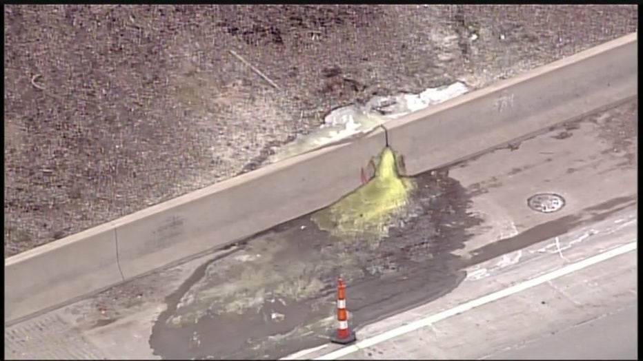 A photo of fluorescent green chemicals coming out of a crack in the side of the wall on I-696..