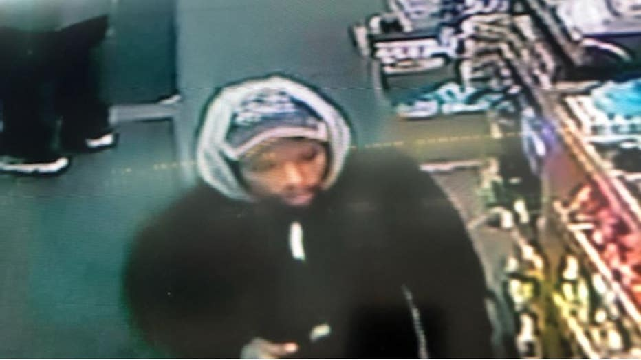 A surveillance photo that shows a suspect wanted for a deadly shooting on Detroit's east side.
