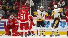 Crosby scores in OT, Penguins beat Red Wings