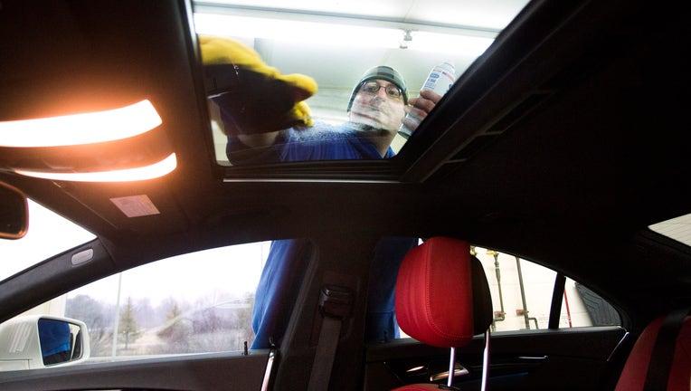 SCARBOROUGH, ME - MARCH 15: Donnie Parker details a vehicle in Scarborough on Tuesday, March 15, 2016. Parker cleans the sunroof on a Mercedes CLS550 Coupe. (Photo by Derek Davis/Portland Portland Press Herald via Getty Images)