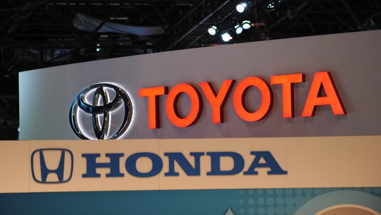 b3ec0a68-The logos for Toyota and Honda are seen at the New York International Auto Show in New York.
