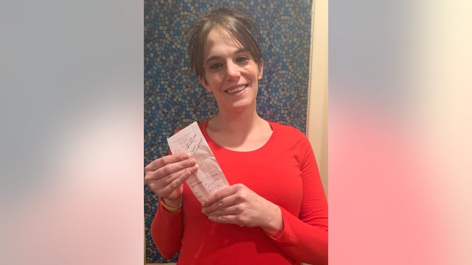 A photo of Danielle Franzoni smiling, holding her tip receipt