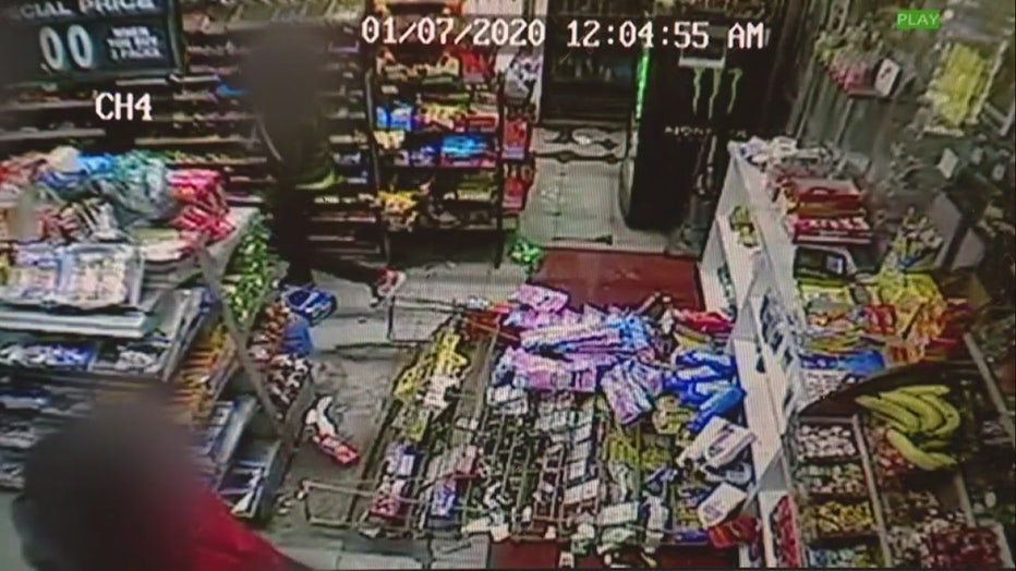 A screenshot from surveillance video showing a knocked over display of food inside a gas station