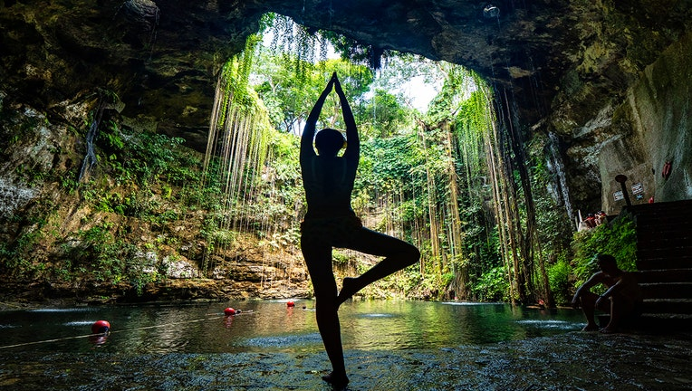 Tourist does yoga in Mexico-400801