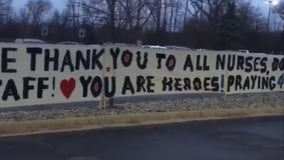 Family posts 45-foot thank you sign outside for Beaumont Troy ICU staff