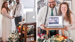 Refusing to let COVID-19 win, couple holds emotional wedding at home with family and friends on Zoom