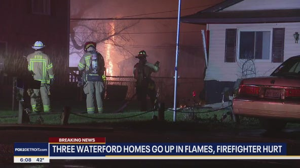 Waterford township homes catch fire after power line falls, one firefighter injured