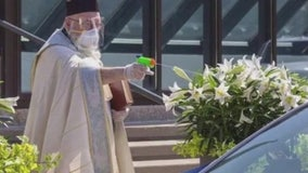 Internet has blast with Grosse Pointe priest's holy water squirt gun for social distance Easter blessings