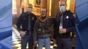 Detroit NAACP outraged at state police photo with armed demonstrator at Capitol