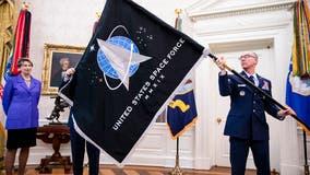 Space Force unveils flag; Trump touts 'super-duper missile'