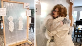 Senior community builds hug station to safely bring joy back to residents