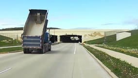 Shocking Video: Dump truck with bed in the air strikes bridge