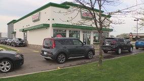 Graduates line up for hours at Krispy Kreme in Troy for donut giveaway
