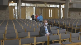 Blocked-off pews and carefully-placed communion, Catholic Mass returns to Detroit Tuesday