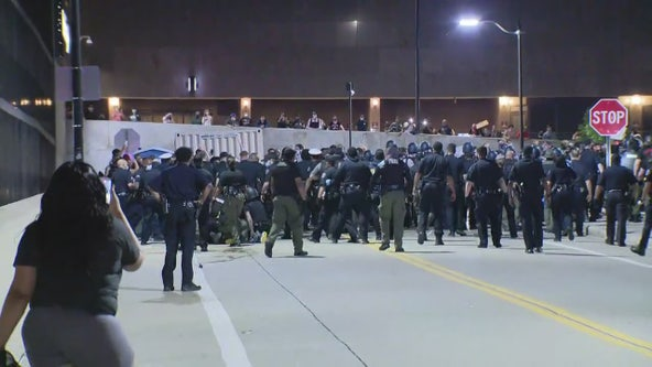 Two Detroit police officers attacked several DPD cars damaged during downtown protest