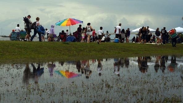 Launch watchers return for 2nd try with patience, umbrellas