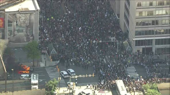 Protesters clash with police outside Municipal Services building in Center City