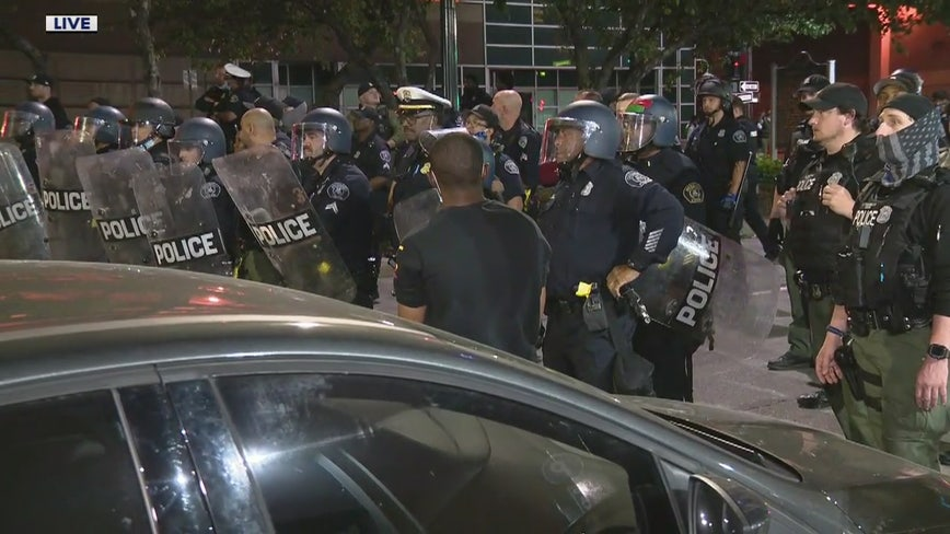 Protesters clash with police in downtown Detroit