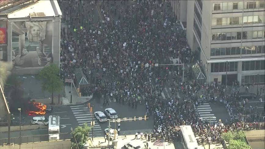 Protestors clash with police outside Municipal Services building in Center City