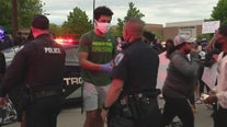 Troy police arrest man after driving into crowd of protesters Monday