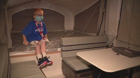 A special boy receives his Make A Wish with custom camper