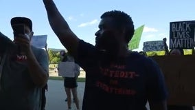 Protesters want white Warren police officer fired after arrest of Black Amazon driver for parking wrong way