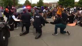 Peaceful demonstration nearly marred by driver trying to run down protester in Troy