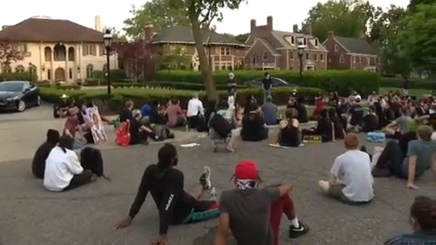 Sit-in protest against 8 p.m. Detroit curfew held outside Manoogian Mansion