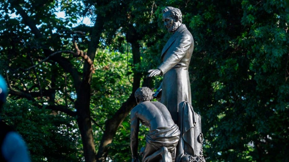 As the wave of anti-racism protests rocking the United States brings down monuments to figures linked to the country's history of slavery, the spotlight is shifting to other prominent people long considered untouchable.