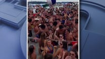 Hundreds crowd popular northern Michigan lake over holiday weekend