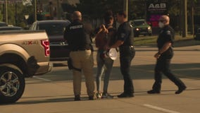 Two arrested for blocking traffic during Shelby Township protest