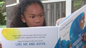 Farmington Hills girl reviews books that include children of color for online blog