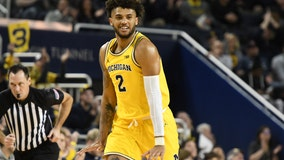 Michigan's Livers forgoing NBA, returning to Wolverines