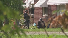 Police continue negotiation tactics with barricaded gunman at Detroit home