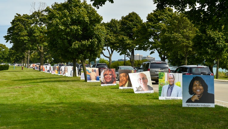 Images of COVID-19 victims from Detroit are displayed in a drive-by memorial at Belle Isle State Park in Detroit, Michigan.